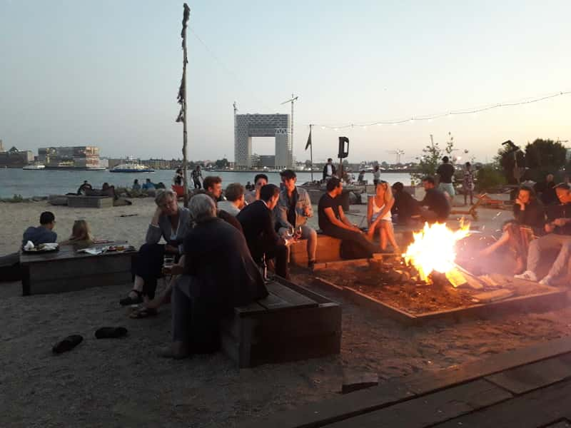 Bon fire in Amsterdam bar with sea view