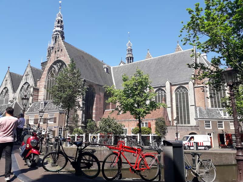 Church in Amsterdam behind the canal. Amsterdam Budget and Review