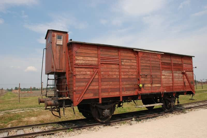 Auschwitz II - Train Wagon on Train Rails - Used to be full of prisoners carrying them to death. Krakow and Auschwitz Tours Warsaw