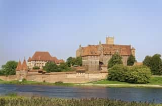 Front view of the Malbork castle behind the river