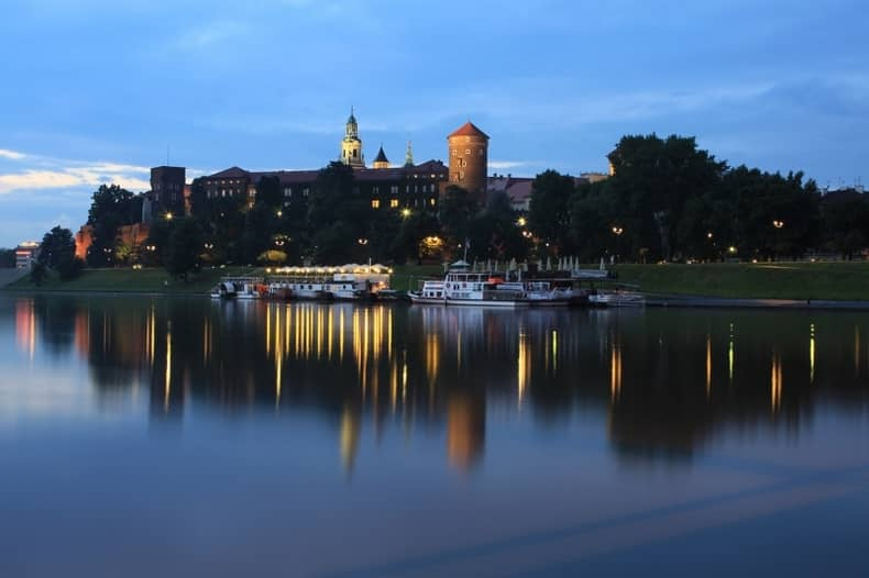 The Krakow's Wawel castle behind the River late afternoon. Beautiful light reflections into the river. This is a Top to See in Krakow, specially at night!!