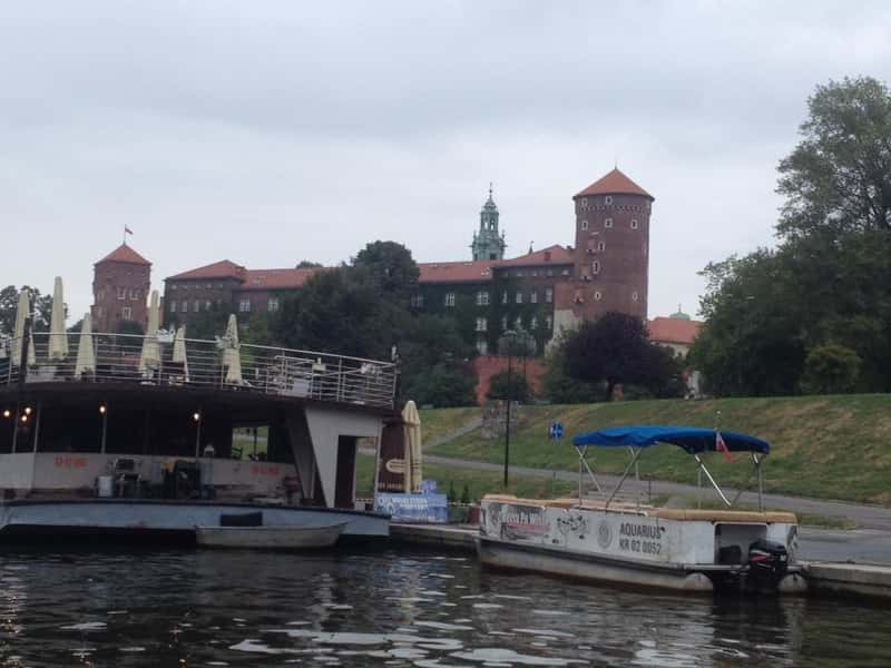 Beautiful view of the Wawel castle in Krakow from the boat in the Wisla river | You can take a boat trip from Kazimierz to the Castle and enjoy the beautiful view.