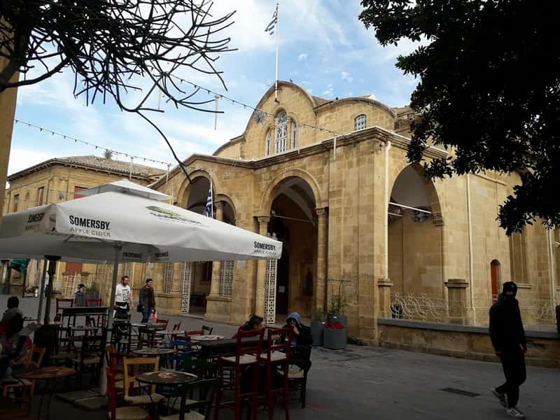 The front side of Panayia Faneromeni Church, next to the borders and surrounded by many cafeterias and bars