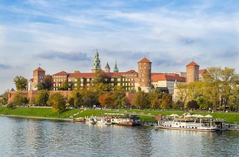 Wawel Castle in Krakow behind the Wisla river during the Day time.