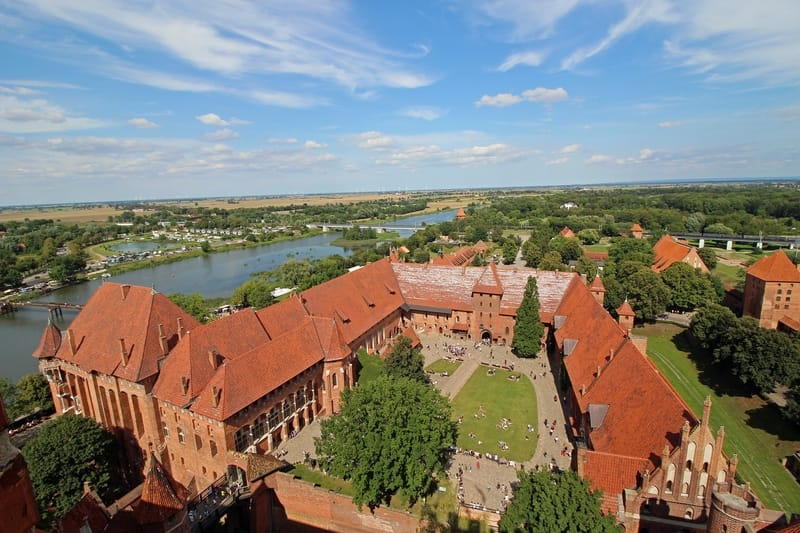 Malbork castle at the Polish sea side. Behind the river during the summer time in Poland - Weather is great for sightseeing