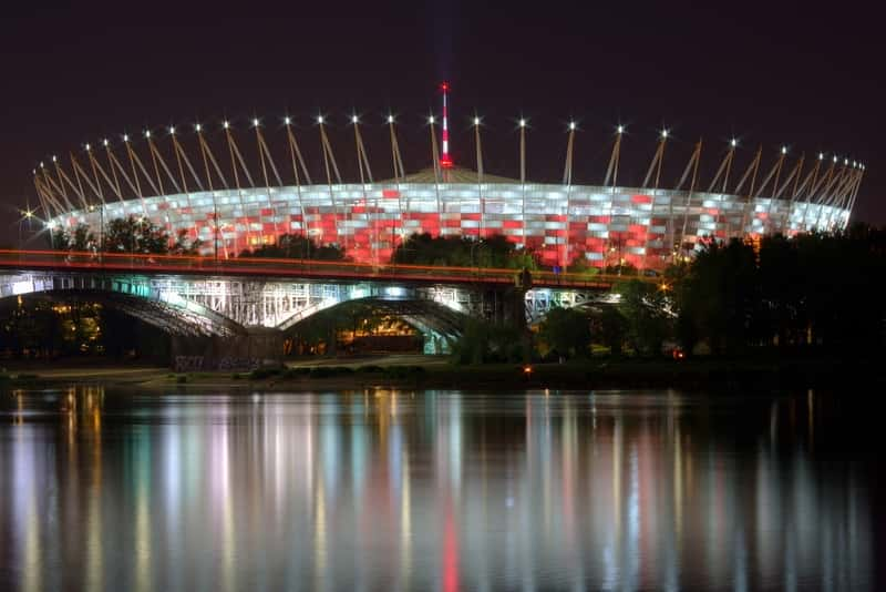 National Stadium in Warsaw behind the Wisła river during the night. Free things to do In Warsaw - Free concerts
