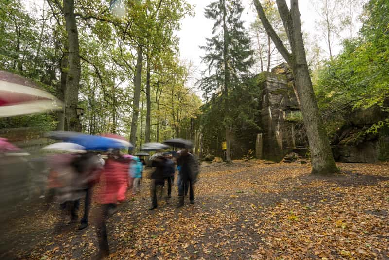 People walking in a tour in Wolf's Lair during Autumn - How to visit the place?
